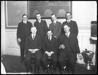 Group portrait of unidentified men at dinner, January 30, 1919. Photographed for James R. Murphy.