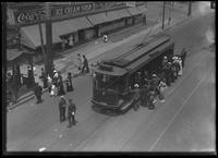 High angle shot of Van Cortlandt Park visitors getting on a trolley near the 242nd Street subway station, Bronx, June 7, 1914. Photographed for Joseph P. Day.