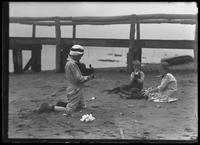 William Gray Hassler photographing two other children on a beach in front of a dock, Palisades Interstate Park, July 5, 1914. Possibly the children of Edna May Smith, Woodland Street, Englewood, N.J.