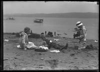 William Gray Hassler photographing two other children on a beach, Palisades Interstate Park, July 5, 1914. Possibly the children of Edna May Smith, Woodland Street, Englewood, N.J.