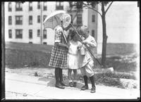 William Gray Hassler showing his baitfish to Dorothy and Daisy Sprore, New York City, undated (ca. 1911-1913).