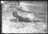 William Gray Hassler in bathing costume playing on the beach (probably Brighton Beach, Brooklyn), undated (ca. 1911-1915).