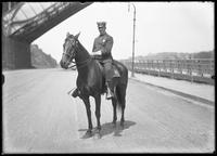 Mr. Sowerby on his horse on the Speedway near High Bridge, New York City, undated (ca. 1905-1911). Washington Bridge visible.