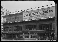 Billboard for the United Electric Shops and for electric signs, New York City, undated (ca. April 1917).