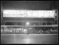 Night view of illuminated UEL&P billboards at W. 145th Street, New York City, October 23, 1915. Photographed for the United Electric Light & Power Company.