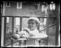 Infant Virginia Bjorkman in a walker on a porch, undated (ca. 1920).