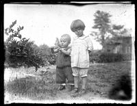 Infant William Bjorkman and toddler Virginia Bjorkman standing in a back garden, undated (ca. 1925-1930).