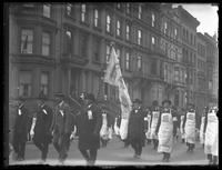 Marchers carrying the Rainbow Division flag in a Liberty Day parade, New York City, October 25, 1917.