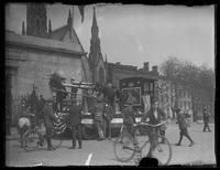 People gathered around a parade float with an artillery piece mounted on it, probably Baltimore, Maryland, undated (ca. 1917-1918).