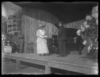 Ernestine Schumann-Heink performing on an outdoor stage with unidentified man, possibly Cleveland, Ohio, undated (ca. 1916-1920).