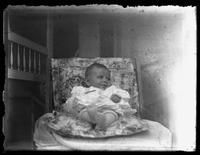 Infant Virginia Bjorkman posed on a chair, undated (ca. 1920-1922).