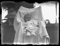 Infant Virginia Bjorkman propped up in a chair, undated (ca. 1920-1922).