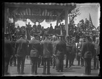 Police officers assembled in front of a viewing stand, being decorated by an unidentified official, New York City (?), undated (ca. 1920-1925).