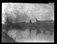 View of the Cuyahoga River and the Cleveland skyline, including Terminal Tower, Cleveland, Ohio, undated (ca. 1936-1937). Emulsion damage.