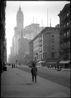 Astor House, St. Paul's Chapel, and the Singer Building from Broadway and Barclay Street, New York City, undated (ca. 1907-1908).
