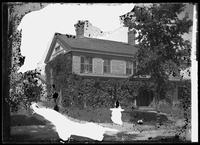 """Clinton House,"" location unidentified, undated (ca. 1882-1919). Heavy emulsion damage."