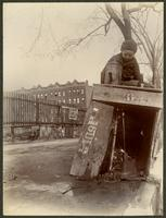 Small boy at a well [?] on the northeast corner of Broadway and W. 124th Street, New York City, April 9, 1898. Printed in reverse.