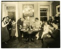 Alice Foote MacDougal entertaining a group of sailors in her small apt in Old War.
