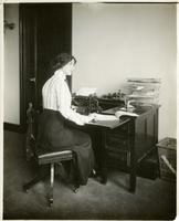 [Model with typewriter].