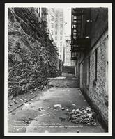 Facing north at rear of 211 Edgecombe Avenue showing retaining wall at rear of 678 St. Nicholas Avenue, Manhattan