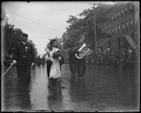 Young girl with flowers marching in parade with veterans [?], Decoration Day, Bronx, N.Y., 1903 or 1909.