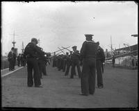 USS Indiana sailors performing a sword drill, Brooklyn Navy Yard, New York City, undated.