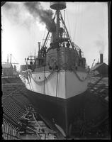 The USS Maine in dry dock, Brooklyn Navy Yard, New York City, undated. View of the bow.