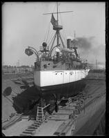 The USS Maine in dry dock, Brooklyn Navy Yard, New York City, undated. View of the stern.