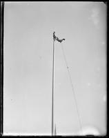 Man balancing on a flagpole, Coney Island, Brooklyn, N.Y., 1903.