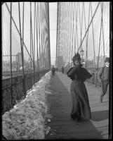 Woman crossing the Brooklyn Bridge in winter, New York City, undated [c. 1897-1905].