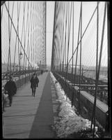 Crossing the Brooklyn Bridge in winter, New York City, undated [c. 1897-1905].