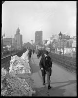 Man crossing the Brooklyn Bridge in winter, New York City, undated [c. 1897-1905].