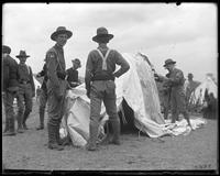 22nd Regiment, Company E raising a tent, State Camp (Camp Smith), Peekskill, N.Y., June 2, 1900.