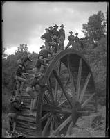 22nd Regiment soldiers posing for photographs on a mill wheel, State Camp (Camp Smith), Peekskill, N.Y., June 16, 1903.