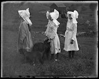 Three unidentified little girls in prairie hats with dogs, Garrison, N.Y., 1900.