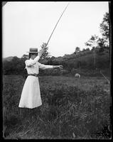 Lulu holding up a fish, Garrison, N.Y., 1901.