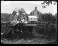 Grace and Edith play with a doll near the Maynard's mailbox, Garrison, N.Y., 1902.