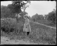 Grace checking for mail, Garrison, N.Y., 1902.
