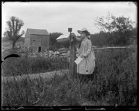 Grace setting the flag on Grand Pop's mailbox, Garrison, N.Y., 1902.