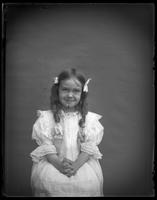Grace sitting with her hands folded in her lap, Bronx, N.Y., undated [c. 1897].