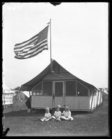 Tent 'Camp Grace Adele,' Orchard Beach, Bronx, N.Y., 1912. Three unidentified little girls seated in front.