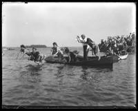 Unidentified girls jumping off a canoe, Orchard Beach, Bronx, N.Y., 1909.