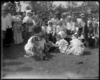Girls putting shoes on for a race [?], Orchard Beach, Bronx, N.Y., 1909.