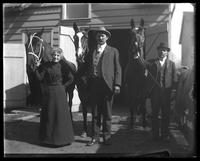 Two unidentified men and a woman ['Maggie Nolan'?] with three horses in front of a stable, Bronx, N.Y. [?], July 24, 1903.