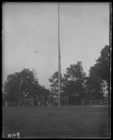 12th Regiment men raising the flag, State Camp (Camp Smith), Peekskill, N.Y., June 29, 1906.