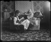 Grace in a rocking chair with her mother lying on a loveseat, Bronx, N.Y. [?], undated [c. 1899?].