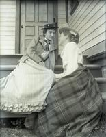 Angie and May Voorhees sitting on the  stoop at the sitting room door, gossiping, Hempstead, N.Y., June 9, 1891.