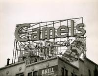 Camel cigarette electric billboard over the Brill Building, 1619 Broadway, New York City.