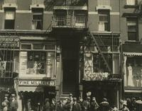Storefronts and pedestrians at 42 Clinton Street, New York City.