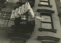 Laundry hanging outside tenement building, New York City.